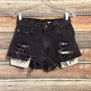 Levis 560 vintage high rise distressed shorts